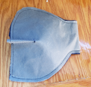 Photo of the chin line being sewn into the MakerMask: Fit