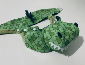 Masks for Children: Dragon shaped novelty mask with extended face parts added to front of mask.