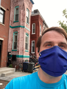 Masks for the Blind: Matt White sporting a blue nonwoven polypropylene face mask for COVID-19, a MakerMask: Surge, outside of his Washington D.C. apartment