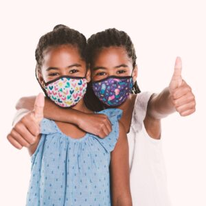Two children wearing fabric masks diving the thumbs up