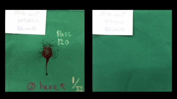 Photo of spundbond nonwoven polypropylene (NWPP) material that passed ASTM F1862 fluid resistance testing. (left) Green NWPP showing splatter of syntethic blood on the outside surface. (right) the inside surface of the same fabric sample showing that it successfully prevented the blood from penetrating to the inside of the mask.