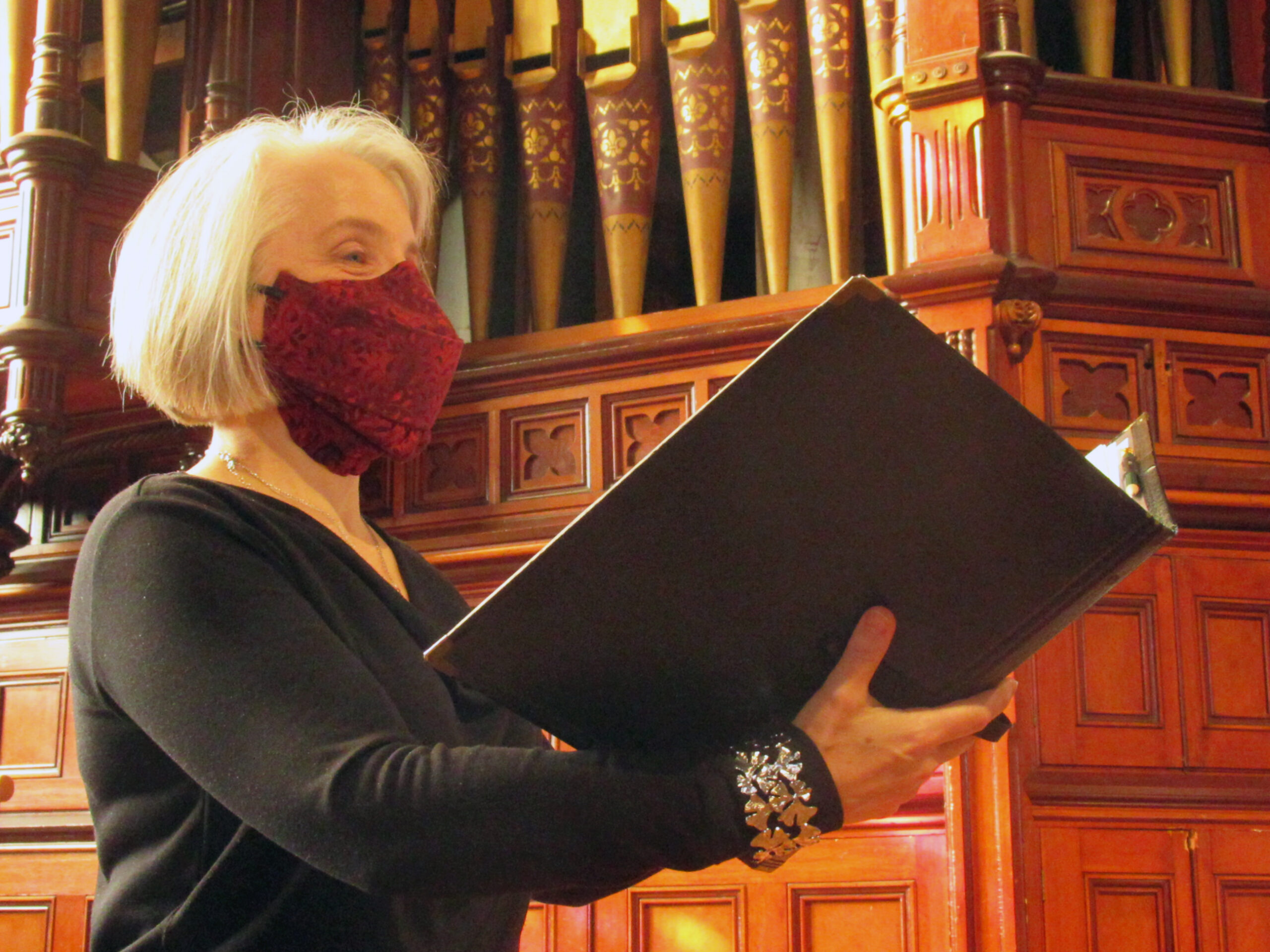 "A singer wearing a three-layer ""singer's mask"" while performing during the COVID-19 pandemic"